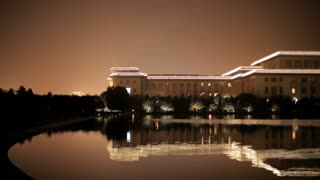 WS PAN Great Hall of the People next to National Grand Theater reflecting in lake at night / Beijing, China