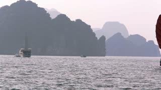 WS PAN Junk boat with red sails and passenger ship in bay / Ha Long Bay, Vietnam