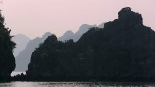 WS PAN Limestone islands in Ha Long Bay at dusk / Vietnam