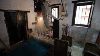 WS PAN Men weaving on looms / India