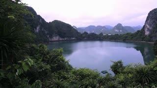 WS PAN Rock formations reflecting in lake / Ha Long Bay, Vietnam