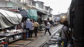 WS PAN Train going through middle of busy market / Thailand