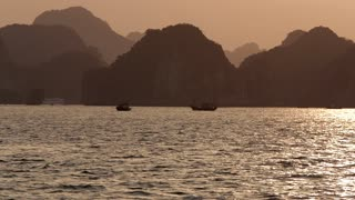 WS PAN TU Boats in Ha Long Bay at sunset / Vietnam