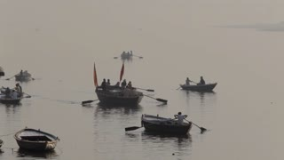 WS People rowing boats in Ganges river / Varanasi, India