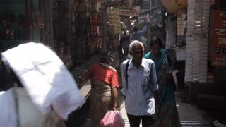 WS People walking down alley / Varanasi, India