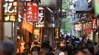 WS People walking down busy street / Macau, China