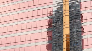 WS Reflection of building on shiny building's surface / Hong Kong, China