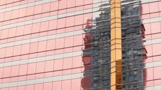 WS Reflection of building on shiny building's surface / Hong Kong, China