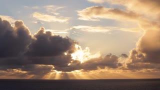 WS Sun breaking through clouds over ocean