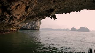 WS View to other side of rock arch in Ha Long Bay / Vietnam