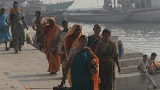 WS Women walking along river Ganges / Varanasi, India