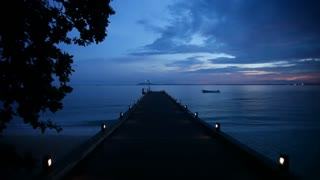 WS Wooden pier in ocean at sunset / Indonesia