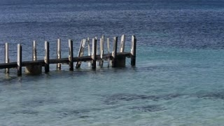 WS Wooden pier jutting out to sea / Australia