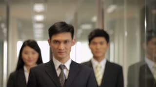 ZI CU Portrait of three business people standing in hallway / China