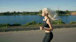 Athletic Woman Running near the Beach. Female Runner Jogging. Outdoor Workout