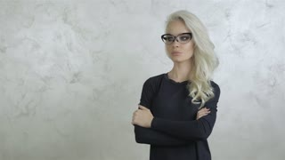 Beautiful Young Blonde Woman with Glasses 1