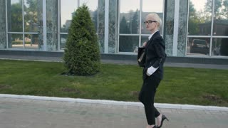 Business Woman Walking Outdoor In City. Office Worker In Downtown
