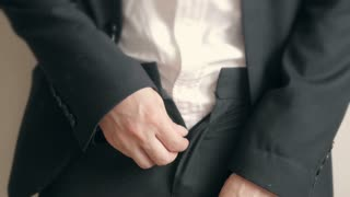 Businessman can t cope with the button trousers. Overweight businessman