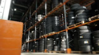 Car Tires At Warehouse In Tire Store. A Huge Warehouse of a Car Tires Stored On Shelves