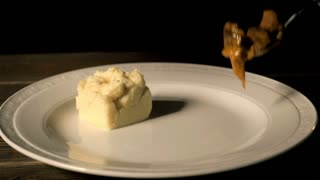 Chef Serves Beef Stroganoff With Mashed Potatoes On a Plate