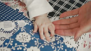 Close up of Newborn Baby's and Mother Hand