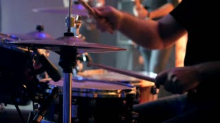 Drummer playing of drums during a concert on special event