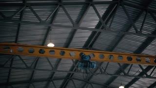 Factory overhead crane inside a factory building