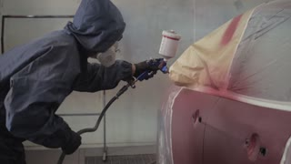 Footage of a Car being Painted by Painting Gun