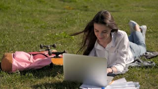 Front View of a Student Girl Working With Laptop In Park of a University Campus