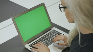 Girl Using Touchscreen on Phone with Green Screen in Office 3