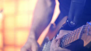 Guitarist stratocaster on stage for background, colorful, soft focus and blur