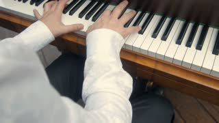 Hands Playing Old Piano
