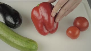 Hands Slicing Red Bell Pepper Macro Healthy Food Concept.