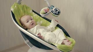Happy Little Cute Baby Girl Swing in Electric Bouncer
