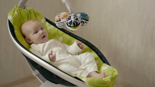 Happy Little Cute Baby Girl Swing in Electric Chair Bouncer
