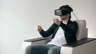Man Wearing Virtual Reality Glasses Watching Movies or Playing Video Games.  VR Headset technology concept