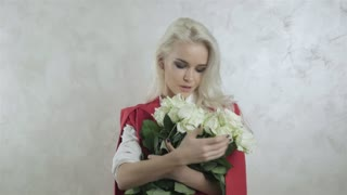 Portrait of Beautiful Young Blonde Woman with Flowers 1