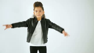 Portrait of Stylish Little Girl In Casual Style Clothes Dancing And Having Fun