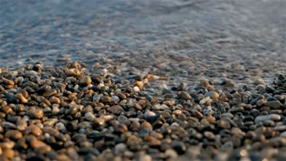 Sea Braking Against Stones And Pebbles On a Beach, Waves of Pure Water