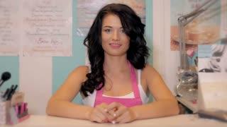 Small business owner portrait. Portrait of young entrepreneur wearing apron. Caucasian female beauty shop owner