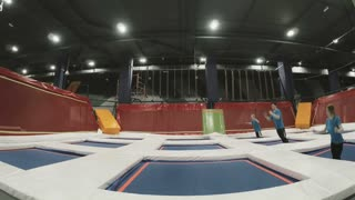 Three Professional gymnasts doing trcks on trampoline synchrone. Amazing tricks by Group of Gymnasts