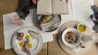 Top Healthy Breakfast of Oatmeal Porridge, Eggs, Granola, Juice, Bacon, Nuts in Modern City Cafe