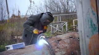 Welders Repairing Heavy Equipment Outdoor