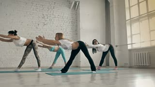 Yoga Class, Group of People Relaxing and Doing Yoga. Womans Wellness and Healthy Lifestyle