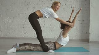 Yoga Trainer Helps Female Student To Stretch Back, Sport Practice With Partner