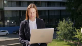 Young Beautiful Business Woman Using Laptop PC Outside Business Center