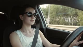 Young Beautiful Women Behind The Wheel of a Car, Travel On The Road