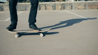 Young experience skateboarder flipping his skateboard underground