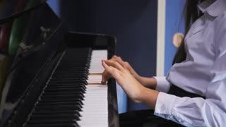Young Girl Playing Piano in School Class. Schoolgirl on music lessons