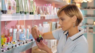 Young woman choosing cosmetic cream in beauty shop